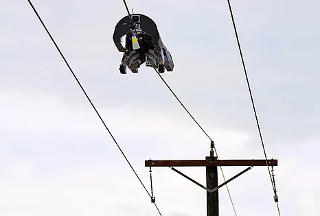 This Facebook robot installs fiber in the power lines